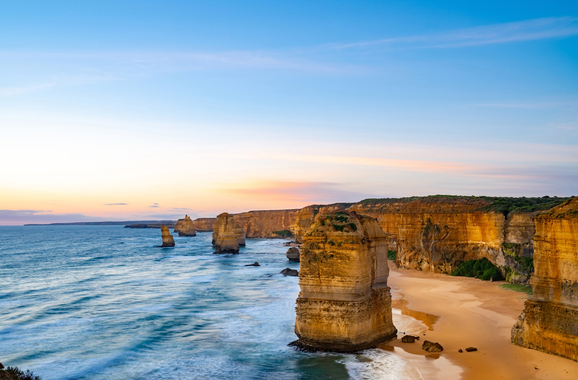 Blue skies across the horizon at the Twelve Apostles