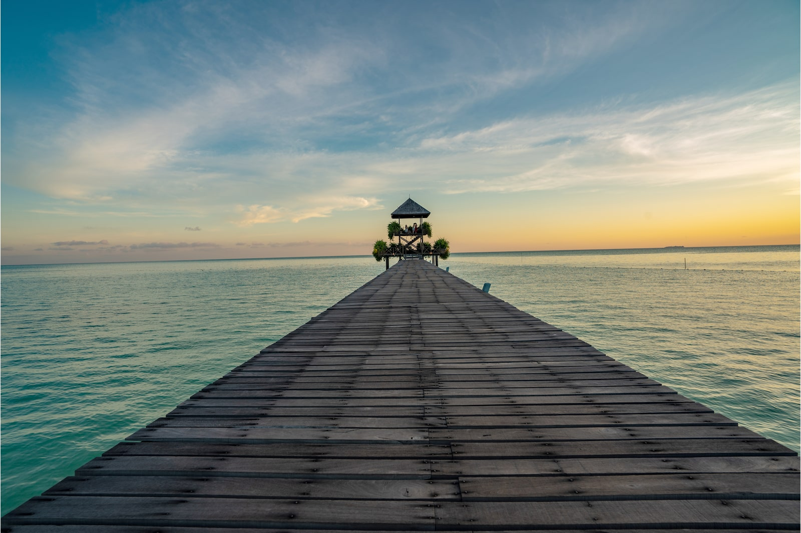 Sunset frontal view of bridge by the sea in Pulau Sipadan