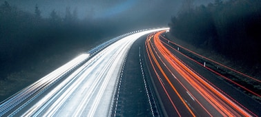 Image of fast-moving highway at night