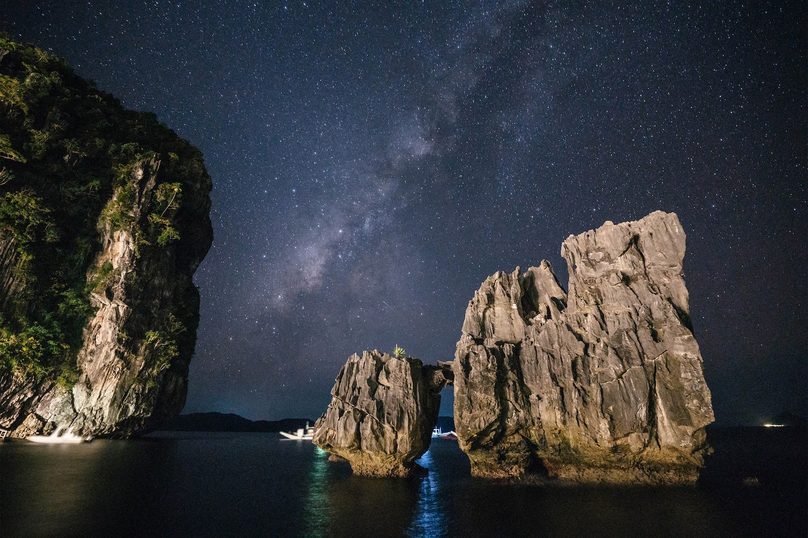 El Nido rock formations against starry night skies