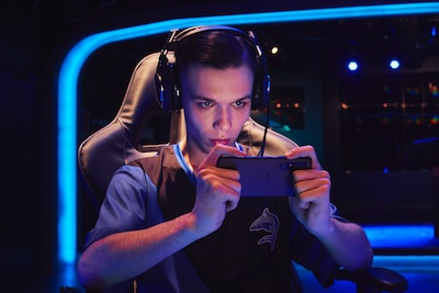 Person gaming on Xperia 1 III with a headset on