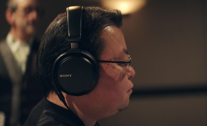 Kenichi Matsumoto listening through headphones