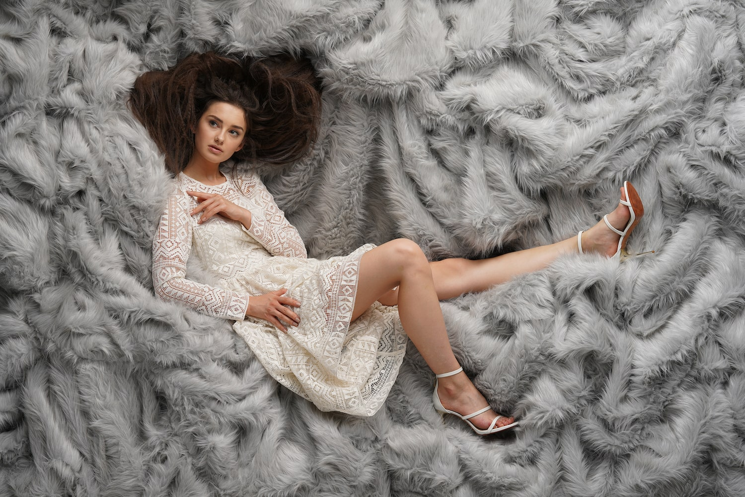 model-in-white-dress-against-fur-background-alpha-7RIV